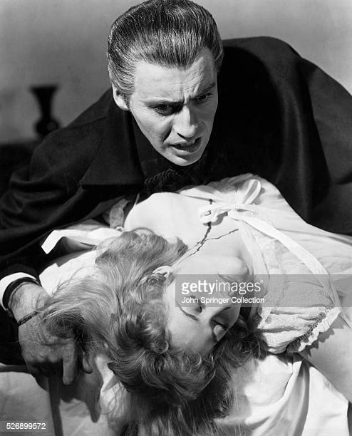 Fiendish Christopher Lee the human vampire feats on the blood of Melissa Stribling A scene from 'Horror of Dracula' 1958 The new horrorsuspense film...