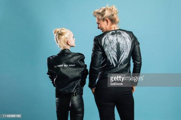 fierce females - leather jacket stock pictures, royalty-free photos & images