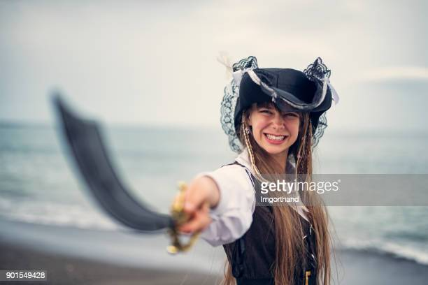 fierce pirate girl holding a sabre - period costume stock pictures, royalty-free photos & images