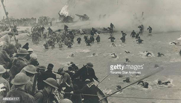 Fiercely attacked by Stuka dive bombers British Tommies wade and swim to rescue boats standing off the beach at Dunkirk Along with other pictures on...