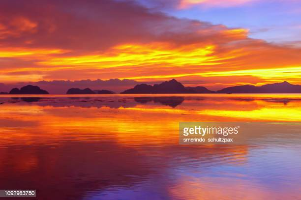 fierry sunset - el nido stock pictures, royalty-free photos & images