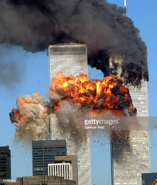 Fiery blasts rocks the south tower of the World Trade Center as the hijacked United Airlines Flight 175 from Boston crashes into the building...