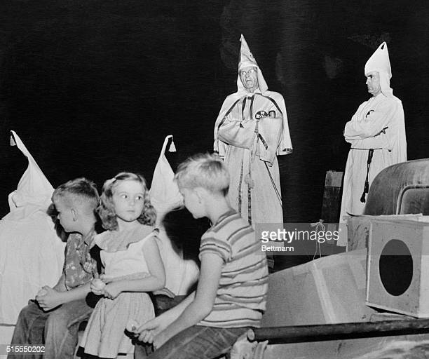 Fiery crosses of the Ku Klux Klan are blazing at night again in the South as protests increase over the prospect of ending racial segregation in the...