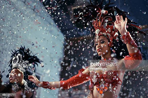 fiery festival dancers - brazilian carnival stock pictures, royalty-free photos & images
