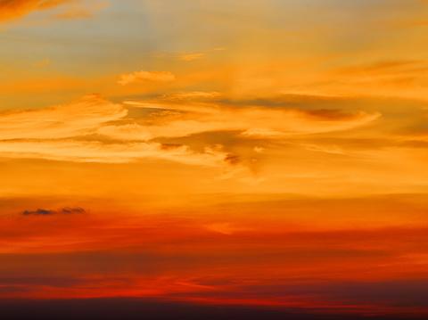Fiery orange sunset sky. Beautiful sky background. 938911334
