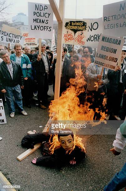 Fiery protest Demonstrators burn Housing Minister Dave Cooke in effigy at Queen's Park yesterday to protest against proposed NDP rentcontrol...