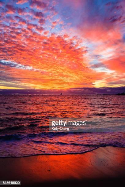 fiery sunset at fremantle beach - フリーマントル ストックフォトと画像