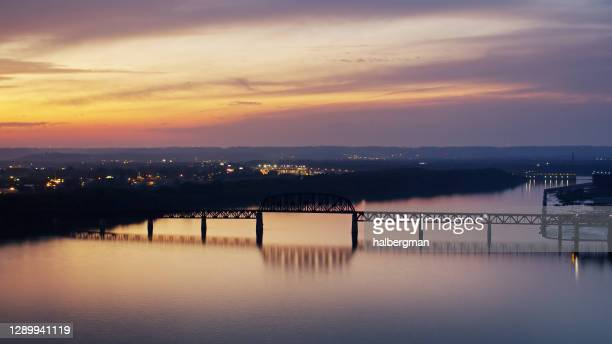 fiery sunset in kentucky from across the ohio river - louisville kentucky stock pictures, royalty-free photos & images