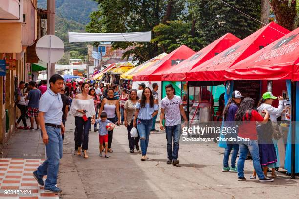 Fiesta In San Francisco, Cundinamarca In The South American Country Of Colombia - Local People And Stalls On Plaza Mayor