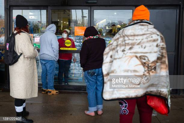 Fiesta Mart staff member tells customers that the store is closed because of a power outage in Austin, Texas on February 17, 2021. Millions of Texans...