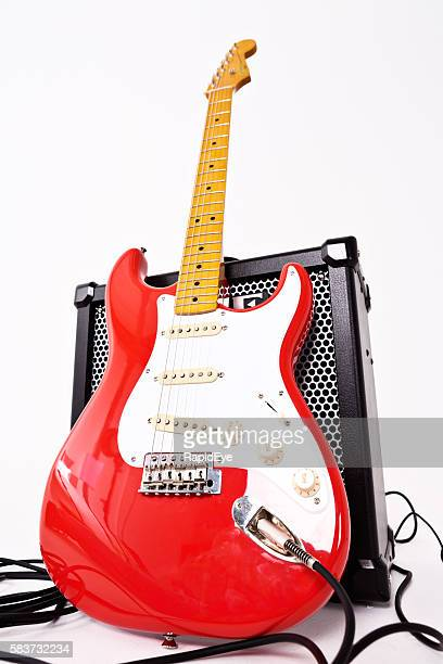 Fiesta Red Classic Vibe Stratocaster electric guitar, with Roland amp