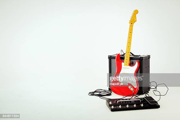 fiesta red stratocaster electric guitar, roland amp and effects unit - brand name stock pictures, royalty-free photos & images