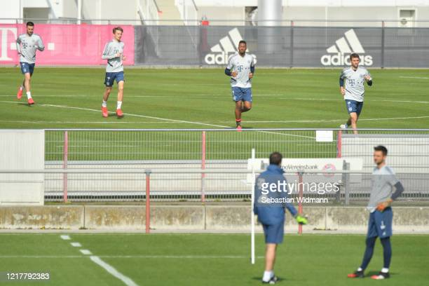Fiete Arp, Jerome Boateng and Thomas Mueller of Bayern Muenchen run during a training session at Saebener Strasse training ground on April 09, 2020...