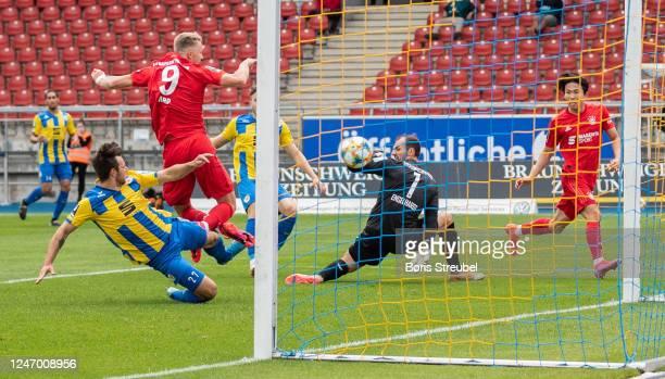 Fiete Arp of Bayern II scores his team's first goal past goalkeeper Marcel Engelhardt of Eintracht Braunschweig during the 3. Liga match between...