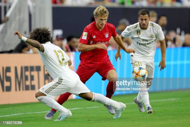 Fiete Arp of Bayern Muenchen baattles for the ball with Marcelo of Real and his team mate Eden Hazard during the International Champions Cup match...