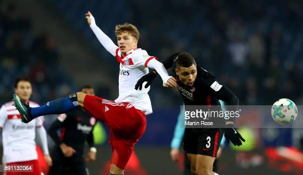 Fiete Arp of Hamburg and Simon Falette of Frankfurt battle for the during the Bundesliga match between Hamburger SV and Eintracht Frankfurt at...