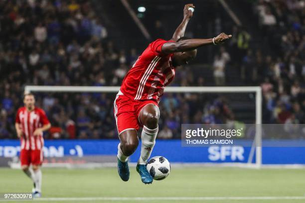 TOPSHOT Fifa 98's retired Jamaican sprinter Usain Bolt controls the ball during an exhibition football match between France's 1998 World Cup's French...
