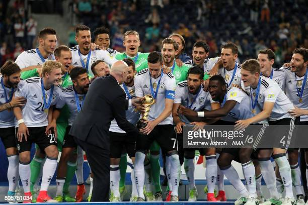 Fifa President Gianni Infantino gives the trophy to Julian Draxler of Germany at the end of the FIFA Confederations Cup Russia 2017 Final match...