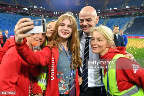 Fifa President Gianni Infantino poses for a selfie with volunteers after the FIFA Confederations Cup Russia 2017 Final match between Chile and...