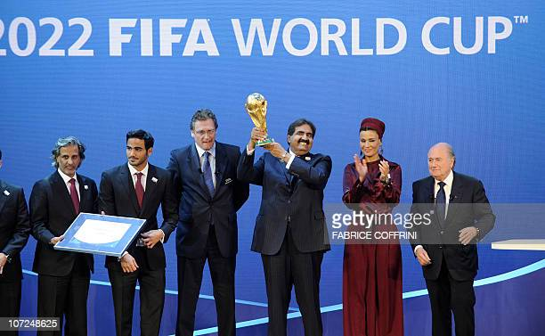 Fifa President Joseph Blatter hands over the World Cup trophy to the Emir of the State of Qatar Sheikh Hamad bin Khalifa AlThani and his wife Sheikha...
