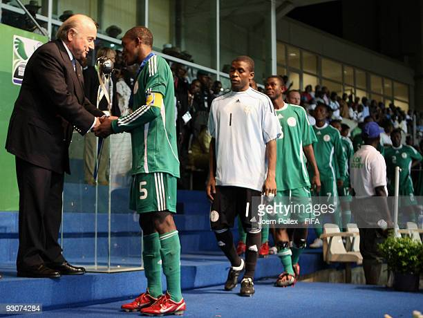 Fifa President Joseph S Blatter congratulates the captain of Nigeria Fortune Chukwudi after the FIFA U17 World Cup Final between Switzerland and...