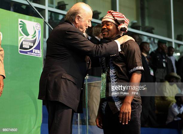 Fifa President Joseph S Blatter congratulates the head coach of Nigeria John Obuh after the FIFA U17 World Cup Final between Switzerland and Nigeria...
