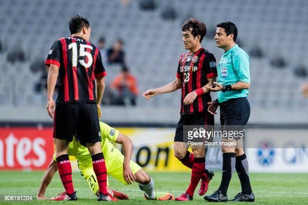 Fifa Referee Alireza Faghani of Iran talks to FC Seoul Midfielder Lee Seokhyun during the AFC Champions League 2017 Group F match between FC Seoul vs...