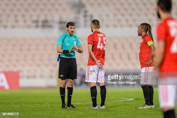 Fifa Referee Omar Mohamed Ahmed Hassan Alali talks to Carlos Leonel Gois of Benfica Macau during the AFC Cup Group I match between Benfica Macau and...