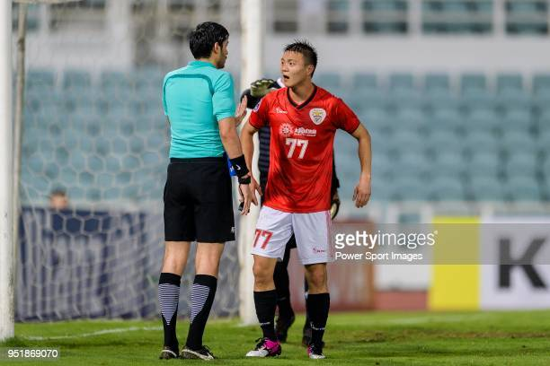 Fifa Referee Omar Mohamed Ahmed Hassan Alali talks to Chan Man of Benfica Macau during the AFC Cup Group I match between Benfica Macau and 425 SC at...