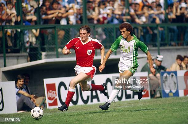 Fifa World Cup 21 June 1982 Algeria v Austria Austrian defender Bernd Krauss in a chase for the ball with Lakhdar Belloumi