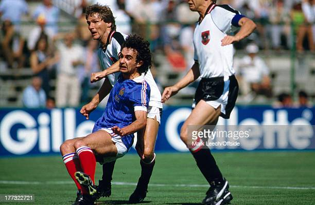 Fifa World Cup 28 June 1982 Austria v France Dominique Rocheteau falls under pressure from Austrian defenders