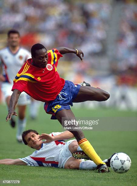 Fifa World Cup Yugoslavia v Colombia Freddy Rincon of Colombia is tackled from behind