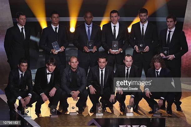 Fifa World XI award players back row l to r Marco Van Basten who presented the awardRonaldoMaiconLucioGerard PiqueIker Casillas front row l to r...