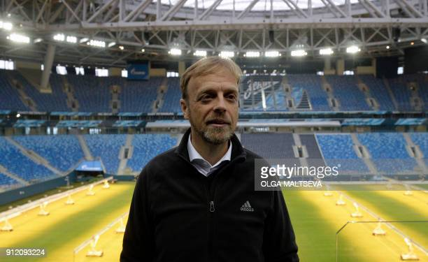 FIFAs Chief Tournaments and Events Officer Colin Smith tours the Saint Petersburg Stadium in Saint Petersburg on January 30, 2018. / AFP PHOTO / Olga...