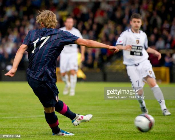 Arvydas Novikovas fires the ball home to further increase Hearts' advantage