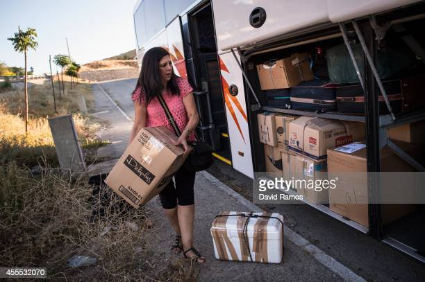 Fifi Navarro loads her belongings on a bus before travelling towards France to work during the grape harvest on September 6 2014 in Alcala del Valle...