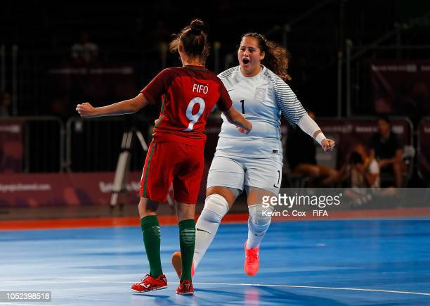 Fifo of Portugal celebrates scoring the first goal against Japan with goalkeeper Marta Costa in the Women's Futsal Final match between Portugal and...