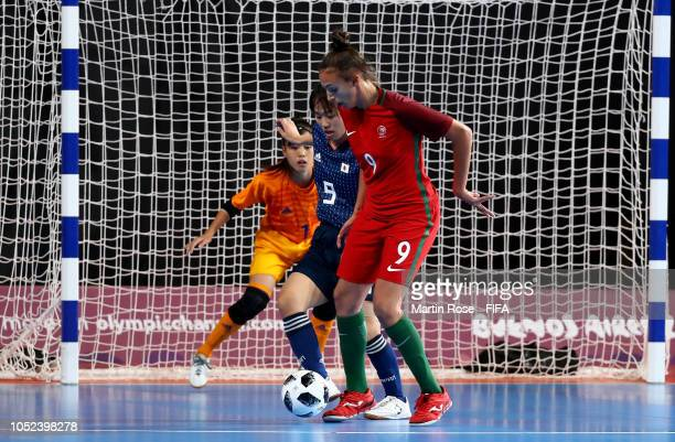 Fifo of Portugal challenges Rikako Yamakawa of Japan in the Women's Futsal Final match between Portugal and Japan during the Buenos Aires Youth...