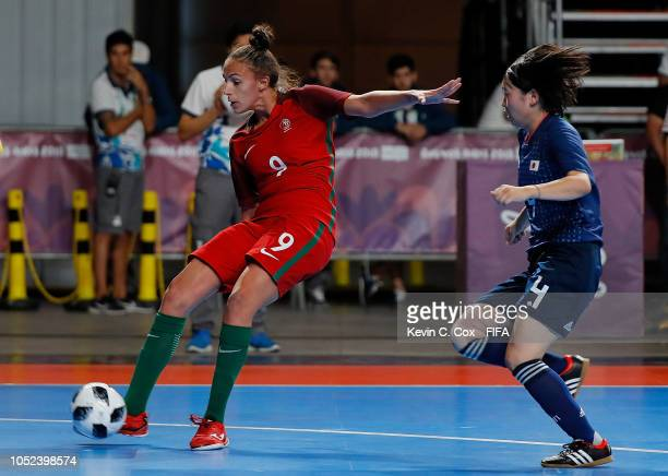 Fifo of Portugal scores the second goal in front of Miu Maeda of Japan in the Women's Futsal Final match between Portugal and Japan during the Buenos...