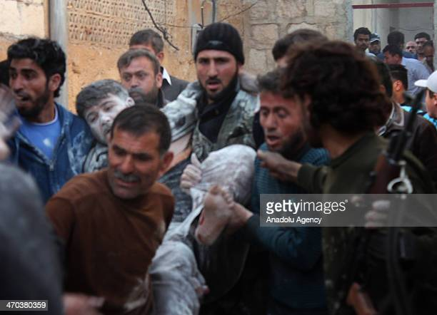 Fifteen people have been killed and 40 wounded as Syrian army helicopter dropped barrel bombs on Etarib district of Aleppo Syria on February 14 2014...