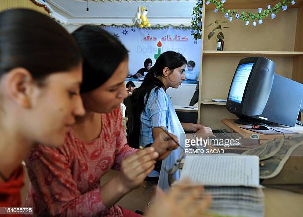Fifteen year old Afghan Maria Mohammad Fahim and others study for school in the library of Mehan Orphanage in Kabul on September 26 2009 The...