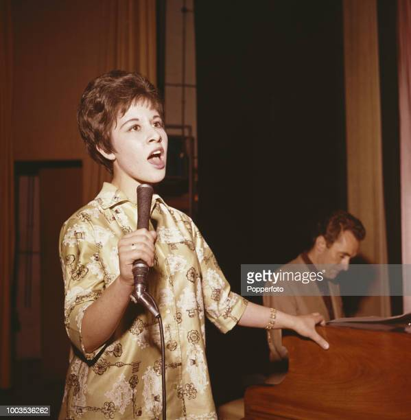 Fifteen year old English pop singer Helen Shapiro pictured rehearsing at a venue in England in October 1961 Helen Shapiro would go on to have two...
