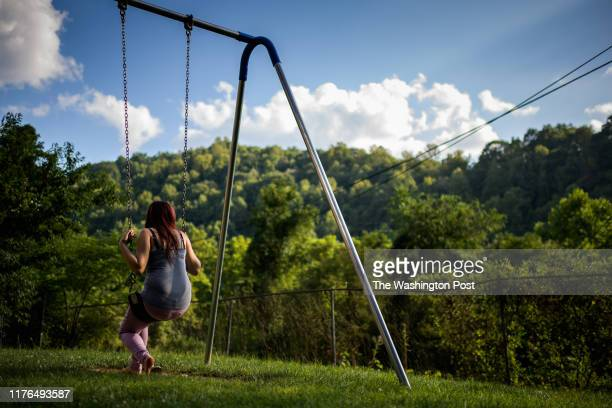 A fifteen year old foster girl who just arrived sits on the swing at the Paul Miller Home emergency children shelter on Tuesday August 6 in Northfork...