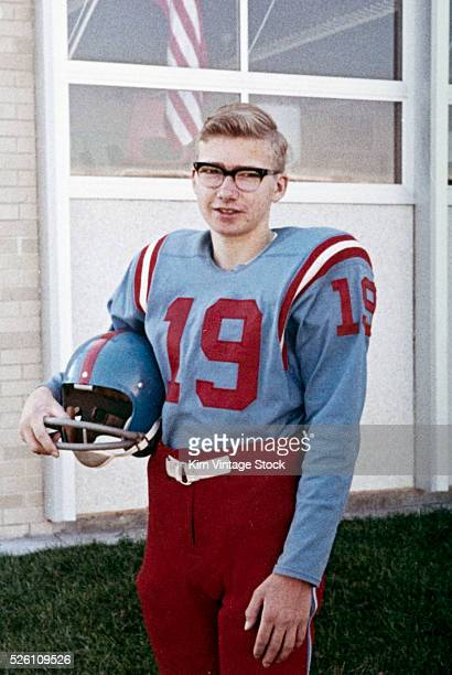 Fifteen year old high school football player portrait outside the school ca 1961