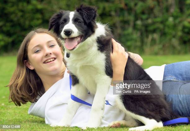 Fifteen year old Kelly Fountain greets Bruiser a puppy that belonged to the BBC Castaways on the island of Taransay will be taking up home with Kelly...