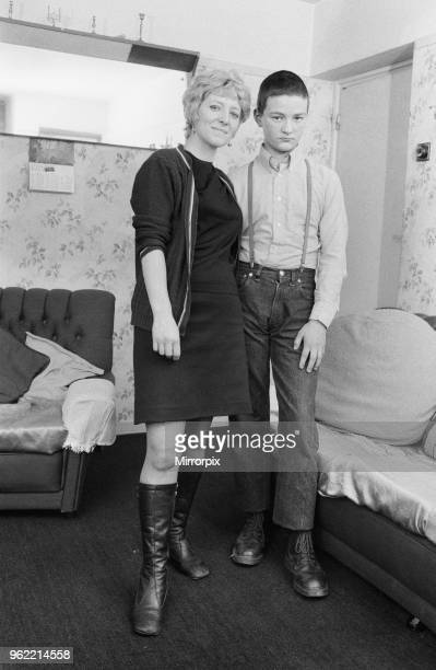 Fifteen year old skinhead Chris Harward poses at home with his mother Joan at their flat in Streatham South London 10th April 1970