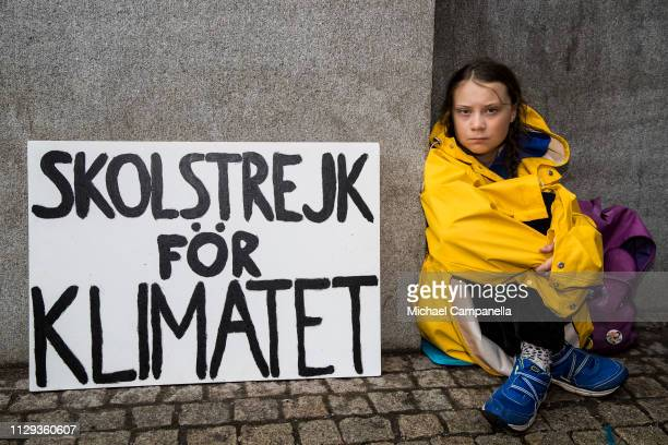 Fifteen year old Swedish student Greta Thunberg leads a school strike and sits outside of Riksdagen the Swedish parliament building in order to...
