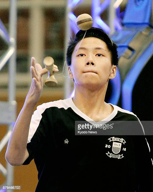 Fifteenyearold Bryson Lee of the United States plays 'kendama' a traditional Japanese wooden ballandcup toy game during the Kendama World Cup event...
