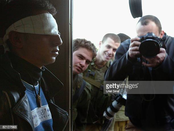 Fifteen-year-old Palestinian is blindfolded and arrested at the Hawara checkpoint, on February 3, 2005 at the entrance to the West Bank city of...
