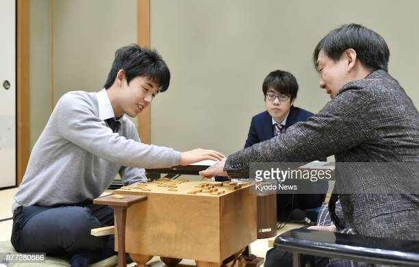 Fifteenyearold Sota Fujii Japan' youngest professional shogi player and 54yearold player Shingo Hirafuji reflect on their match in Osaka on Nov 21...